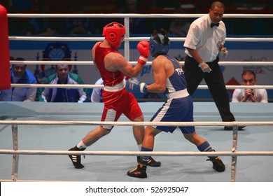 boxing uppercut right hand St. Petersburg, Russia, November 21, 2016 AIBA Youth World Boxing Championships  men heavy 81 kg. Boxing match between: RED-  Rustamov  S., Uzbekistan  BLUE -Kan   Taipei,