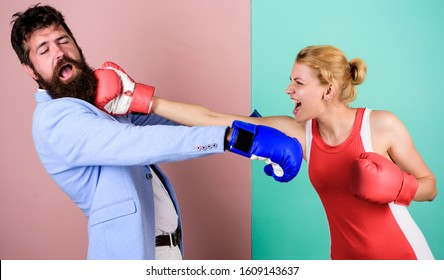 boxing workout. bearded man hipster fighting with woman. problems in relationship. sport. Strength and power. knockout punching. who is right. win the fight. family couple boxing gloves.
