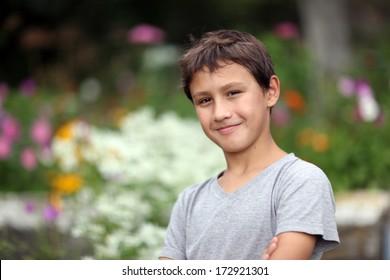 boy 10 years old against summer flower