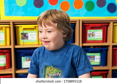 Boy (5-6) with Down syndrome in kindergarten