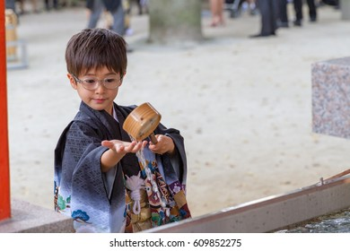 A boy of 7 in a kimono fishes for decorative fish at a Japanese shrine during the 7-5-3 Ceremony, a rite of passage each November 15
