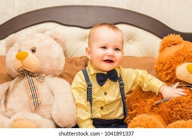 boy 7 months old with a teddy bear