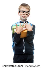 boy 8 years old with a pile of textbooks on a white background in the studio