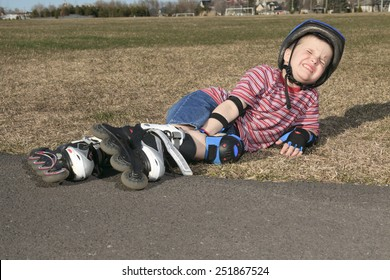Boy accident, rollerblading outdoor on a sunny summer day