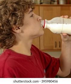 Boy, age twelve, drinking milk from the bottle