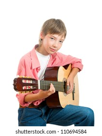 A boy aged 12-14 years holding an acoustic guitar