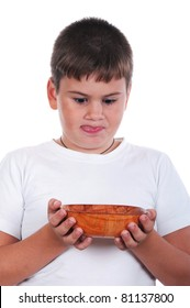 Boy is appetizing looks at a plate on a white background