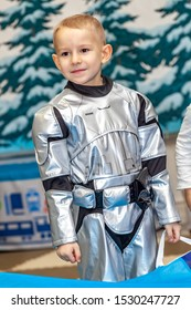 boy in astronaut costume at Christmas celebration