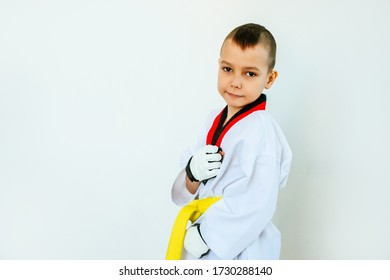 a boy athlete stands in a stand on a white background