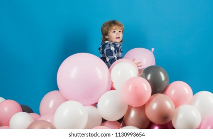 Boy and balloons. Pink and blue children's background. Happy game on balls mountain. Free game. Happy child. Entertainment Center. Birthday of the child. Cute baby. Gifts and products for children