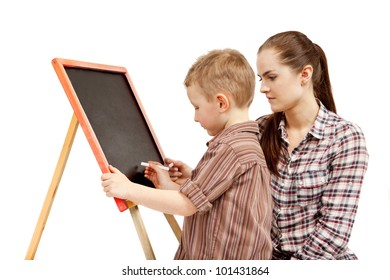 The boy begins to write on the blackboard. He wants to draw or write something. The young woman is  watching what he does.