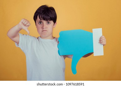 boy with a big dislike on yellow background
