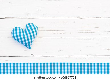 Boy birthday baby shower party background with cute little blue heart shape on white wood.