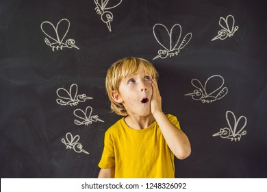 The boy is bitten by mosquitoes on a dark background. On the blackboard with chalk painted mosquitoes