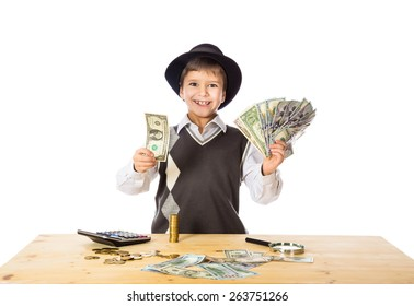 boy in black hat counting money on the table, isolated on white
