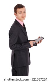Boy in a black suit hold a tablet PC isolated on white