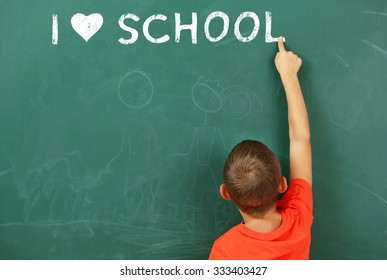 Boy at the blackboard. I love learning concept