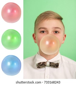 Boy blowing a bubblegum bubble isolated on green. Plus three blanks