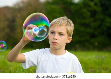 boy is blowing soap bubbles