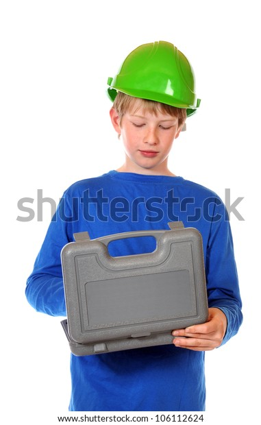 Boy in blue shirt and green protection helmet in front of a white background