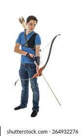 Boy with blue shirt and jeans holding a longbow