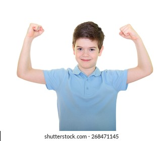 Boy in blue t shirt showing his arms strength over white background