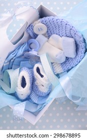 Its a Boy blue theme baby shower gift box with baby clothes, bib, bonnet, booties, pacifier and socks.