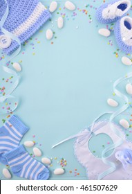Its a boy, blue theme Baby Shower or Nursery background with decorated borders on pale blue wood background.