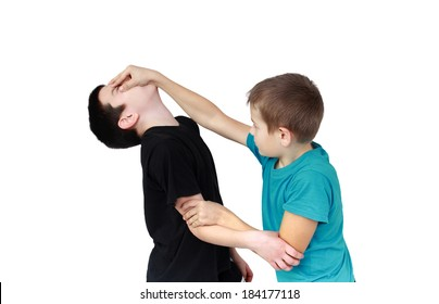 Boy in blue T-shirt holds reception against the boy in a black T-shirt