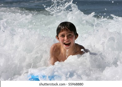 Boy body surfing in the sea
