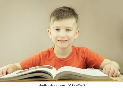 Boy with a book.