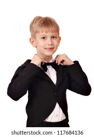 boy with bow tie and black tuxedo suit