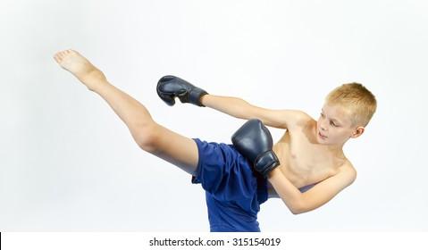 Boy in boxing gloves beats punch leg