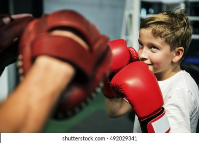 Boy Boxing Training Punch Mitts Exercise Concept