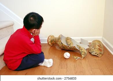 Boy with broken vase and baseball.