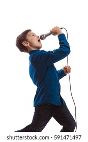 Boy brunette in a blue shirt with a red tie the butterfly with a microphone in hands sings in the studio on a white background