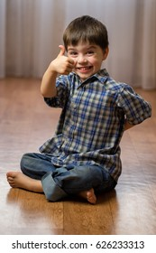 Boy brunette in checkered shirt with brown eyes shows class and smiles