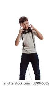 Boy brunette in a white t-shirt with headphones listening to music and dancing on a white background
