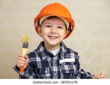 Boy with brush in the helmet.
