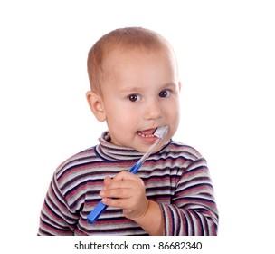 Boy brushing his teeth isolated on white background.