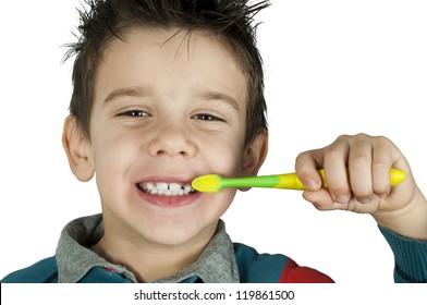 Boy brushing his teeth. White isolated