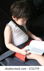 Boy buckle-up seat-belt in the car