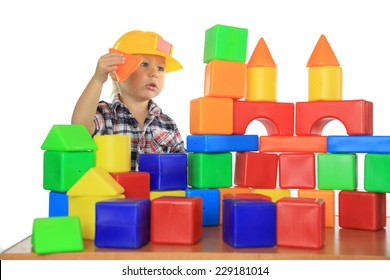boy builds house out of children's blocks
