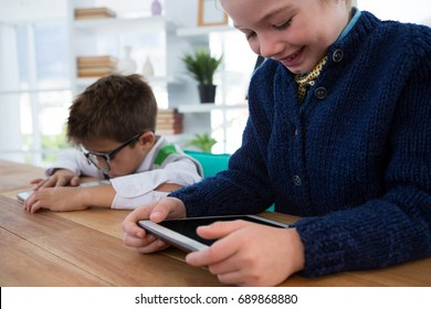 Boy as business executive using digital tablet in office
