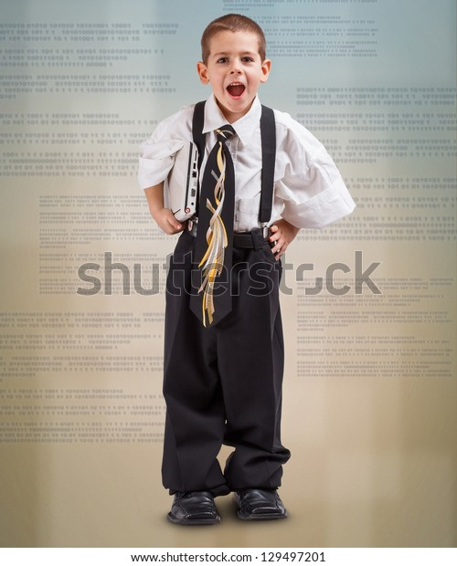 Boy in a business suit with laptop