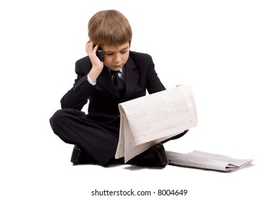 Boy in a business suit with a newspaper and phone, isolated over white