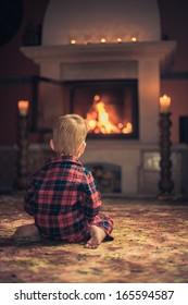 Boy by fireplace