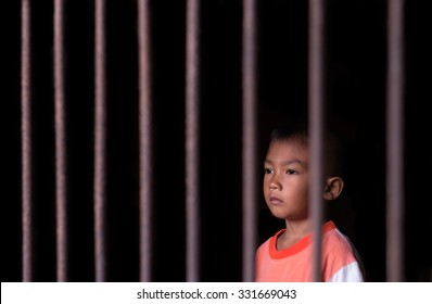 Boy in cage with eye sad and hopeless