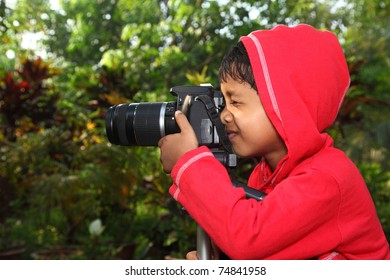 A boy with a camera fixed on tripod