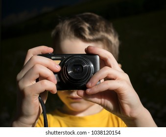 boy with a camera on a dark background